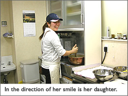 In the direction of her smile is her daughter